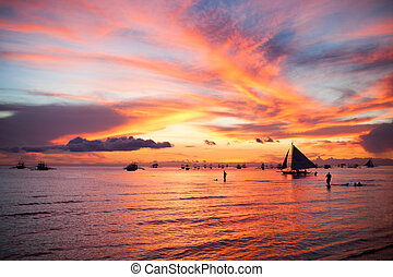 Sailing boat to the sunset in Boracay island on Philippines...