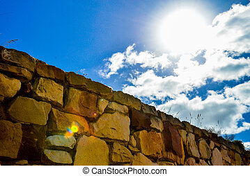 Stone wall with blue sky
