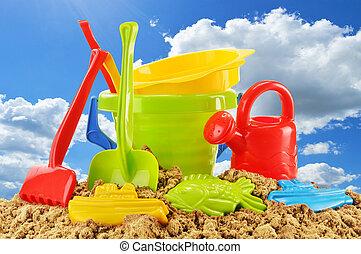 Plastic children toys over the blue sky