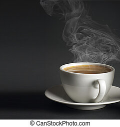 Cup of hot coffee - White cup of hot coffee with steam on...
