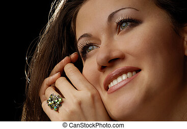 Glad lady with ring - Studio photo of smiling model with...