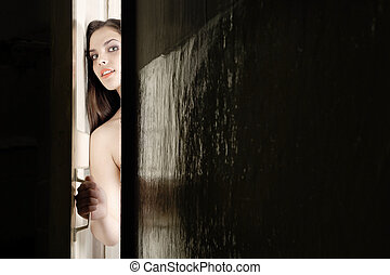 How is my guest - Woman looking from the opening door and...