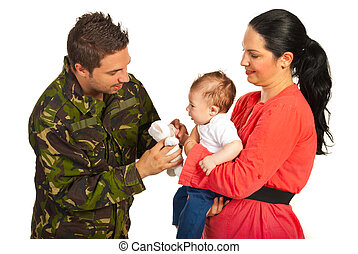 Mother and baby welcoming army dad - Mother and baby...