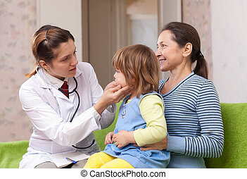 pediatrician doctor examining baby - serious pediatrician...