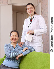 friendly doctor with happy mature woman
