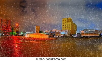 heavy rain over jeddah at night - heavy rain over ring...