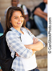 cute high school student with arms crossed - cute female...