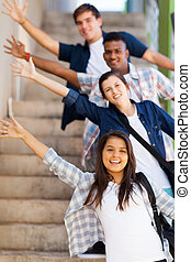 playful high school students - playful group of high school...