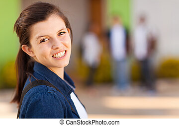 young high school girl smiling - portrait of smiling young...