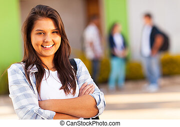 teen high school girl with arms folded - portrait of cute...
