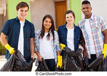 teenage volunteers with garbage bag - cheerful young teenage...