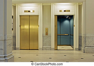 facing elevators - facing twin elevators on first floor, one...