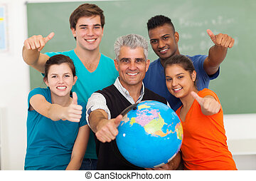 high school students and senior teacher giving thumbs up -...