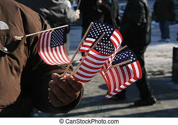 Flags - Man holding miniature American flags
