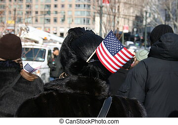 Flag - People watching the Presidential Inauguration at an...