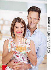 Couple with cake - Happy couple celebrating their...
