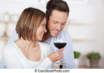 Glass of red wine - Romantic in love couple with a glass of...