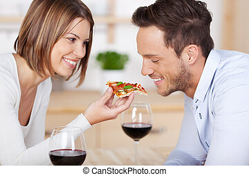 Pizza - Romantic couple drinking red wine with pizza at home