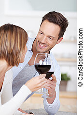 Cheers - Romantic couple dating and cheers with red wine