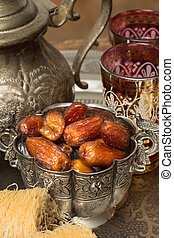 Tea and dates - Silver bowl filled with dates as traditional...