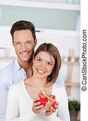 Smiling couple with gift