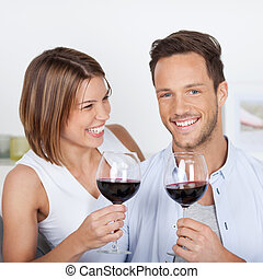 Red wine - Happy couple dating with red wine at home