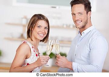 Couple with champagne - Smiling couple dating and drinking...