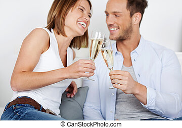 Dating couple - Laughing young couple dating with champagne...
