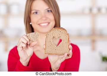 My bread with heart - Slice of bread with a cutout heart...