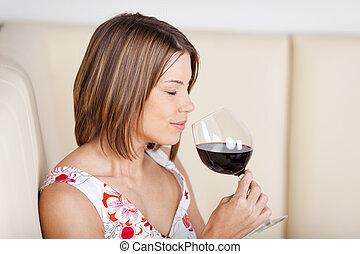Beautiful woman enjoying a glass of wine