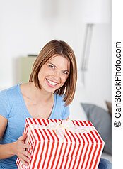 Excited woman with a large striped gift