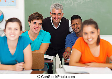 middle aged high school teacher with group of students