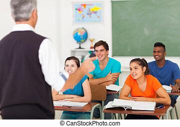 high school teacher teaching students - rear view of high...