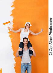 Fun redecorating - Couple is havin fun redecorating their...