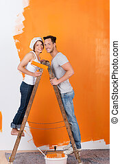 Young couple on a ladder - Young couple is standing on a...