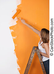 Woman paints apartment - Young woman paints her apartment...