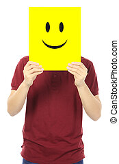 Smiley Face - A young man holding a yellow signboard with a...