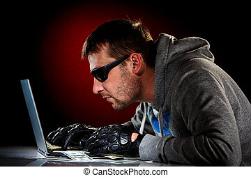 Hacker with laptop - Hacker in a sunglasses with laptop