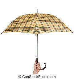 Opened umbrella in hand