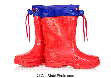 Red rain boots over a white background
