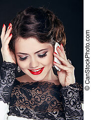 Young happy woman talking on mobile phone. Fashion Brunette Model Portrait. Make Up. Red Lips.