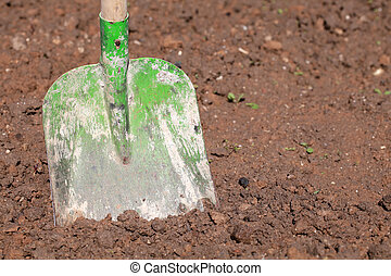 Shovel in soil in a garden
