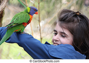 Girl and rainbow lorikeet - Details of a rainbow lorikeet...