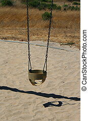 Swings - Close up of swings in a playground.
