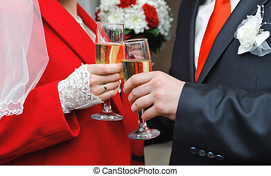 newly married couple holding wine glass in a hands