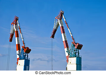 Cranes - Heavy industrial cranes used to load and unload...