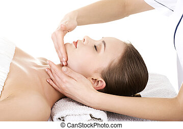 Relaxed woman enjoy receiving face massage at spa saloon -...