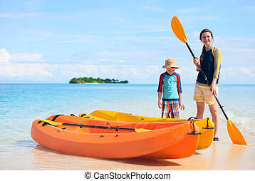 Mother and son with kayaks