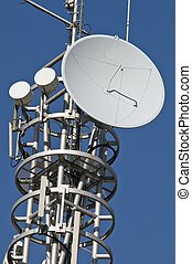 Antenna - Transmission mast with parabolic antenna against a...