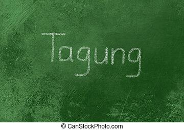 Tagung written on a blackboard